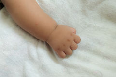 New born baby hand. On bed Royalty Free Stock Photo