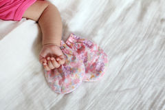 New Born Baby Hand with Pink Color Gloves Stock Images