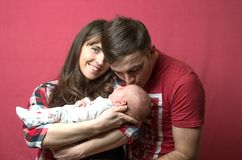 New born baby with his parents. New born baby with parents Stock Photos