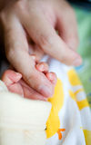 New born baby's hand. Gripping for mothers finger Stock Photography