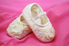 New born baby shoes. On pink Stock Photography