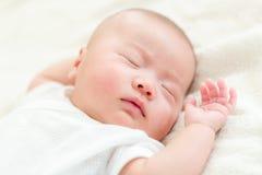 New born baby sleep. Lying on bed Stock Photography