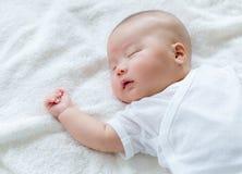 New born baby sleep. Lying on bed Royalty Free Stock Photos