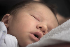 New born baby sleeping Stock Photography