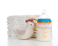 New born child composition stack of diapers toy and baby feeding Royalty Free Stock Image