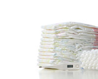 New born child stack of diapers and baby thermometer isolated Stock Images