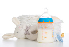 New born child stack of diapers, nipple soother, beanbag bunny Royalty Free Stock Photo