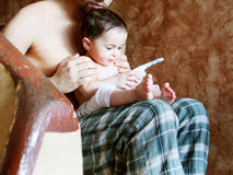 Baby girl. Arabian egyptian newborn baby girl with her father Royalty Free Stock Images