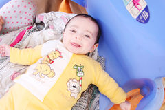 Smiling baby girl. Arabian egyptian newborn baby girl smiling to the cam Stock Photography
