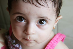 Baby girl. Arabian egyptian newborn girl looking to the cam with brown eyes Stock Photo