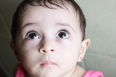 New born girl. Arabian egyptian newborn girl looking with brown eyes Royalty Free Stock Images