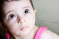 New born girl. Arabian egyptian newborn girl looking above with brown eyes Stock Image