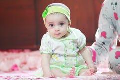 New born girl. Arabian egyptian newborn girl looking to the cam Stock Photography