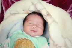 Newborn girl smiling  Royalty Free Stock Photo