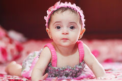 Baby girl. Arabian egyptian newborn girl looking to the cam and crawling Stock Photography
