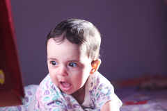 Baby girl staring Royalty Free Stock Photos