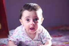 Baby girl staring. Shock of arabian egyptian newborn girl Royalty Free Stock Image