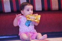 arab muslim baby girl playing with ramadan lantern Royalty Free Stock Image