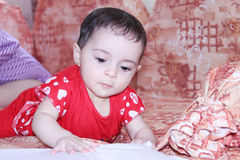 Baby girl. Arabian egyptian newborn baby girl looking playing Royalty Free Stock Images