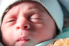 Newborn girl. Arabian egyptian newborn baby girl trying to sleep Stock Photo