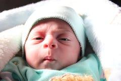 Newborn girl. Arabian egyptian newborn baby girl looking to the cam Stock Photo