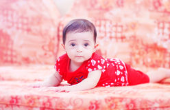 Baby girl smiling. Arabian egyptian newborn baby girl sitting on bench and crawling Stock Images