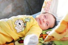 Newborn baby girl. Arabian egyptian newborn baby girl sitting on blanket Royalty Free Stock Images