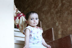 Baby girl. Newborn baby girl looking to the cam and staring Royalty Free Stock Image
