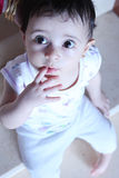 Baby girl. Arabian egyptian newborn baby girl putting finger in her mouse Stock Photography