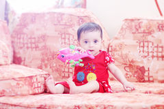 Baby girl. Arabian egyptian newborn baby girl playing with her toy Royalty Free Stock Photo