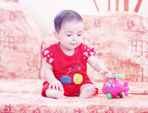 Baby girl playing. Arabian egyptian newborn baby girl playing with her toy Stock Photography