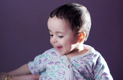 Smiling baby girl. Arabian egyptian newborn baby girl smiling from heart Royalty Free Stock Images