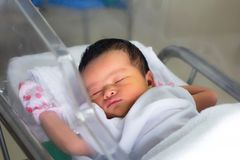 New born. Infant asleep in the blanket in delivery room Royalty Free Stock Images