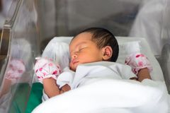 New born. Infant asleep in the blanket in delivery room Royalty Free Stock Photography