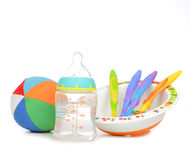 New born infant child composition baby spoons in plate Stock Photo