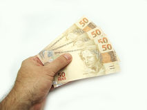 New brazilian currency. And hands royalty free stock photos