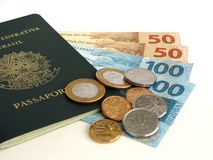 New Brazilian Currency with passport and coins. In white background Stock Photography