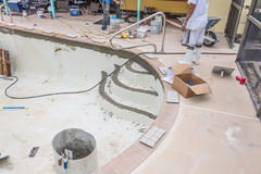 New brick coping and grout pool remodel. Pool repair work and new brick coping and tile step prep Royalty Free Stock Photography