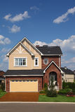 New brick cottage with garage and lawn Royalty Free Stock Images