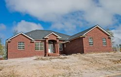 New brick home. Construction on sloped site Royalty Free Stock Photos