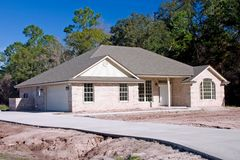 New brick  home 3. Newly constructed brick home with concrete driveway Royalty Free Stock Image