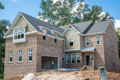 New Brick Home Construction with Sandpile royalty free stock images