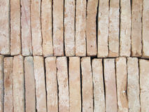 New brick pavers stacked in rows like wall. Store of bricks ready for building or sale. Construction materials and outdoor sto Royalty Free Stock Photography