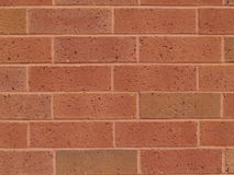 New Brick Red Wall. New red and brown brick exterior wall stock photography