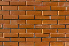 New brick wall. New orange and brown brick wall background Royalty Free Stock Images