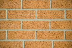 New brick work. Orange backfrob stock images