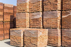 New bricks arranged on pallets Royalty Free Stock Image
