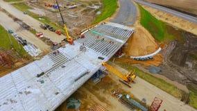 New bridge construction over suburban road. Sky view. Truck repair bridge