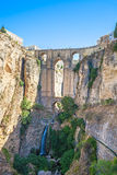 New bridge and falls in Ronda white village. Andalusia, Spain. Stock Photos