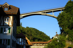 New bridge. FRIBOUTG, SWITZERLAND - CIRCA AUGUST 2015 New concrete arch bridge and houses in Old town Stock Photography